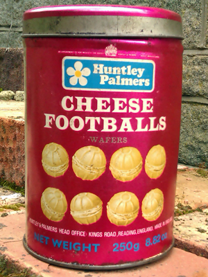 A photograph of a tin of Cheese Footballs.