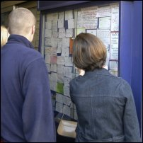 A man and a woman search for accommodation.