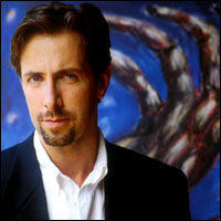 Clive Barker sporting a nice, neat beard. It's the least scary picture we could find of him.