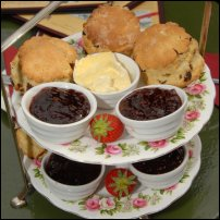 A traditional English cream tea, with Cornish clotted cream at its centre.