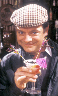 DelBoy from Only Fools and Horses enjoys a cold, refreshing cocktail.
