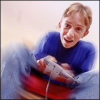 A teenager playing a computer game