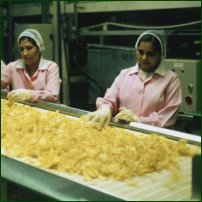 Some workers in a crisp factory.