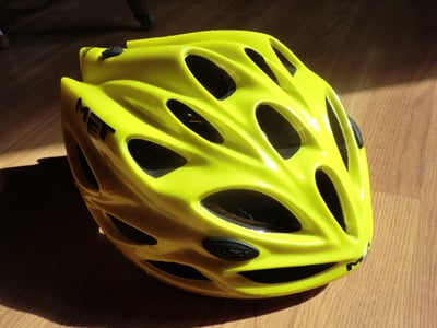 A cyclist's bicycle helmet
