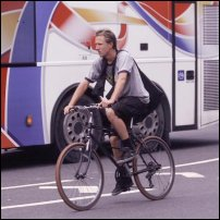 A cyclist navigates city traffic.