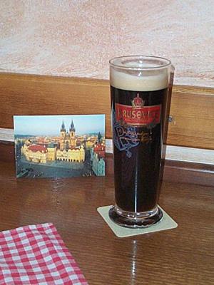 Some Czech dark beer and a postcard of Prague.
