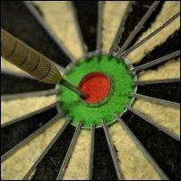 A dart hitting a bullseye.