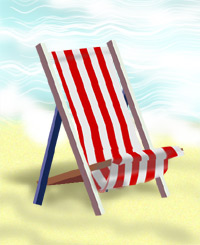 A deckchair on a beach by the water's edge.