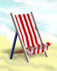 A deckchair on a beach by the water's edge.