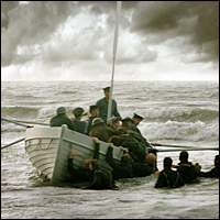 A group of soldiers bring a boat to shore in a recreation of the 1940 Dunkirk rescue, taken from the 2004 drama-documentary Dunkirk.