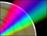 A Digital Versatile Disc with a spectrum of light bouncing off it.
