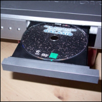 A DVD in a DVD player drawer.