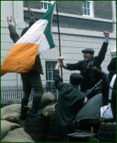 Some actors reenact the Easter Rising.