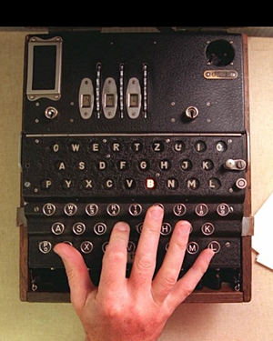 A hand types away at the keys of a piece of Second World War codebreaking equipment at Bletchley Park, Buckinghamshire