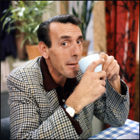 A young Eric Sykes, ace comedy writer and perfomer, enjoying a nice cup of tea.