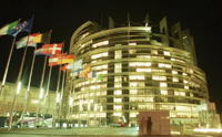 The European Parliament at night.