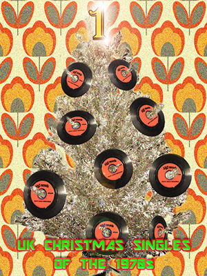 Vinyl singles on a Christmas tree in front of 1970s wallpaper