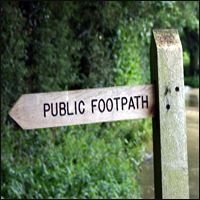 A countryside footpath sign.
