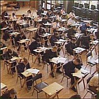 Some students sitting in an exam hall.