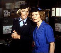 Penelope Keith and Angela Thorne from the classic TV sitcom 'To The Manor Born' - both dressed in Guide Leader outfits.