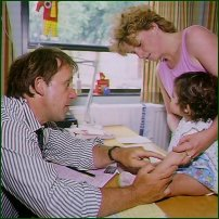 Parent and child at the GP's surgery.