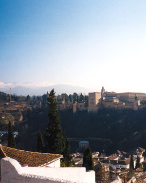 A view from the San Nicolas outlook looking towards the Alhambra and snowy mountains in Granada.