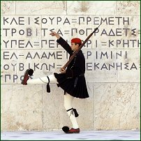 A Greek soldier performs ceremonial guard duty. A Presidential guard marches with his rifle at the tomb of the unknown soldier, in front of parliament in central Athens.