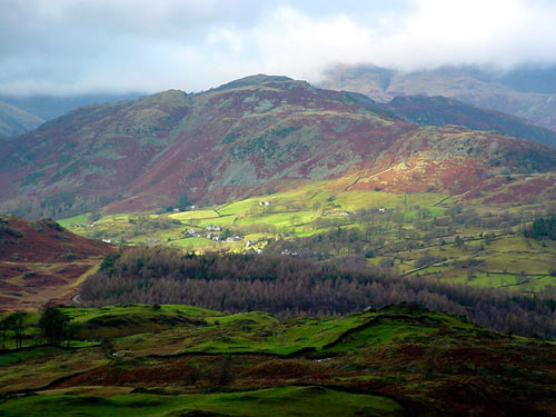 A valley partially illuminated by a ray of sunshine