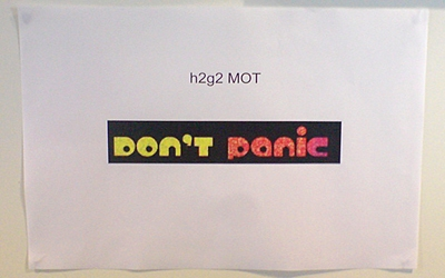 A photo showing the 'Don't Panic' logo with the words 'h2g2 MOT' above, from Nick Reynolds' blog