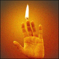 A candle made from a hand. Don't worry, it's not real.