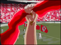 A fist holding a red scarf punches the air in time with the whole stadium to 'Hang on Sloopy'.