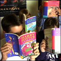 Children reading Harry Potter books.