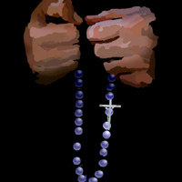 A pair of hands holding a rosary.