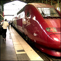 A passenger dashes to catch a train leaving Paris Gare du Nord station.