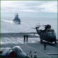 Navy helicopter and sea harriers on the flight deck of HMS Invincible, heading for the Falklands in 1982.