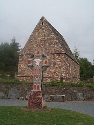 Replica Celtic Christian High Cross and Stone Church.