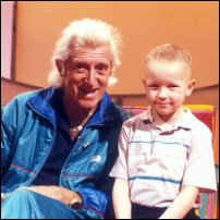 Jimmy Savile 'fixes it' for another member of the public.
