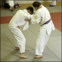 Two men involved in a judo bout.