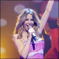 Kylie Minogue wearing a pink dress.