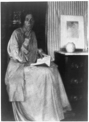 Lady seated, with book.