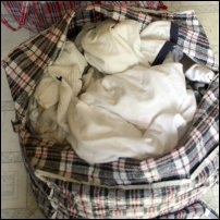 Scrunched-up laundry in a bag.
