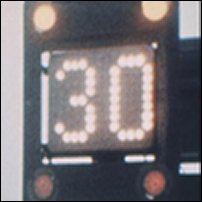 Light-emitting Diodes operating in a fog sign alongside a motorway.