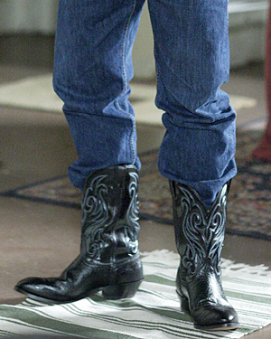 Someone wearing jeans and cowboy boots