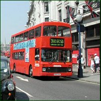 A London double-decker bus in action on Regent's Street.