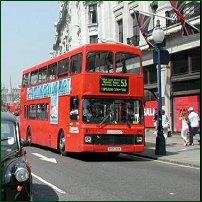A London double-decker bus in action on Regent's Street.