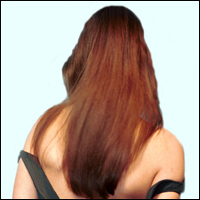 A woman with long, silky hair flowing down her back, her back being turned to the viewer.