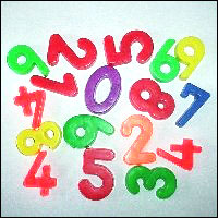 A jumble of brightly-coloured magnetic numbers on a fridge door.