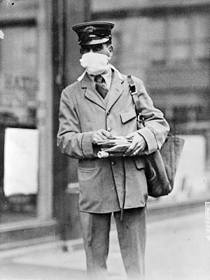 Mail carrier with face mask, 1918.
