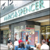 People walking past a Marks and Spencer store.