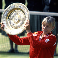 Martina Navratilova holding the Wimbledon Trophy after defeating Chris Evert in the women's final of the Wimbledon Lawn Tennis Championships 1982.